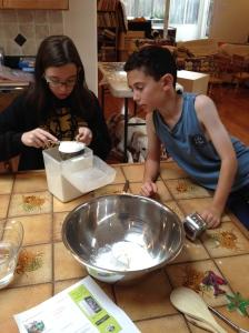 Adding the flour.
