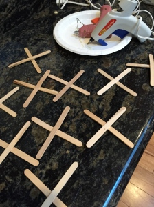 Putting the popsicle sticks together so it was easier for the kids to learn.