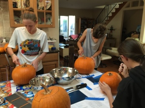 Having fun carving pumpkins.
