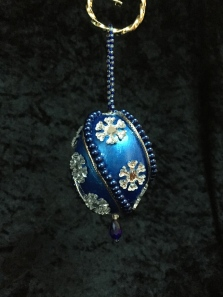 Painted Egg with beads, cording and embelishments.