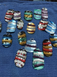 Pendants made from water bottles and acrylic paint.